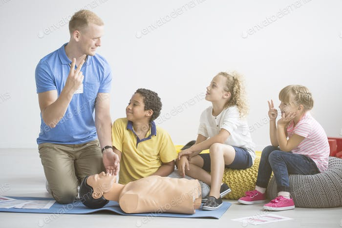 Paramedic and group of children