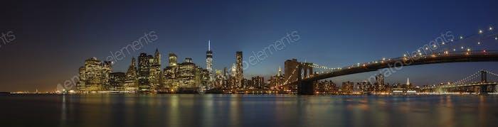 55193,Panoramic view of New York city skyline illuminated at night, New York, United States
