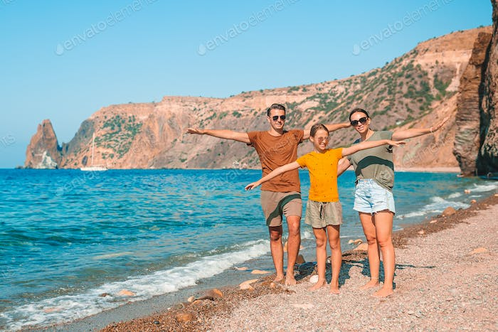 Young family on white beach during summer vacation