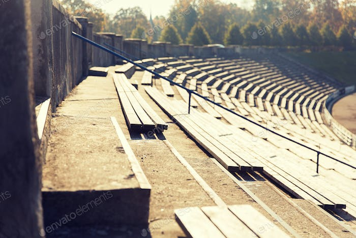 close up of bleachers with benches on stadium