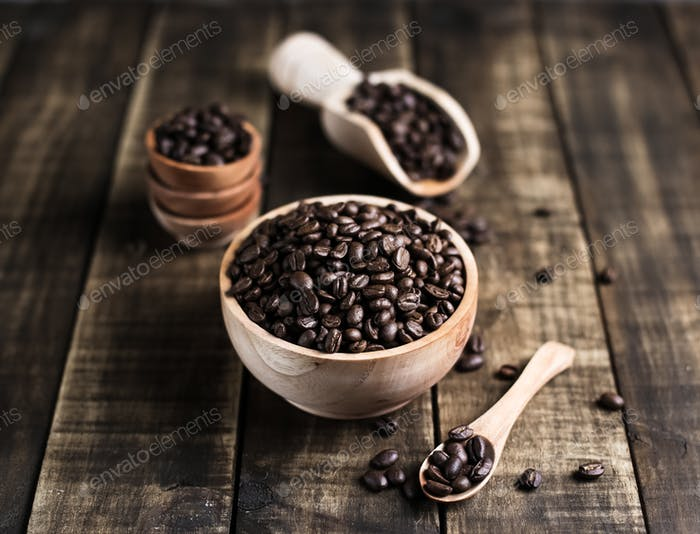 coffee beans with wooden bowl scoop saucer and spoon