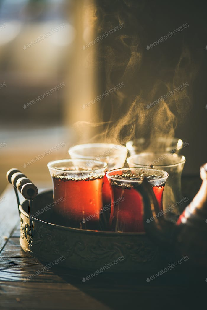 Traditional hot steaming Turkish tea in tulip glasses