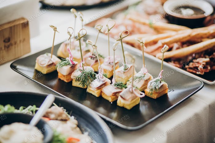 Fish finger appetizers with onion on table