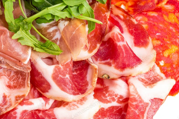 Delicious italian dried meat with arugula.