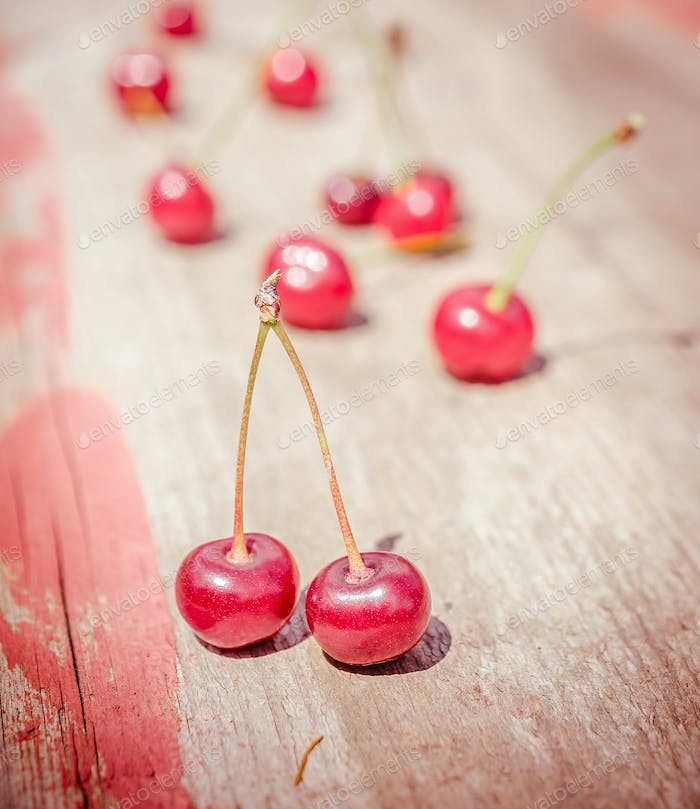 Ripe cherries on the wooden board