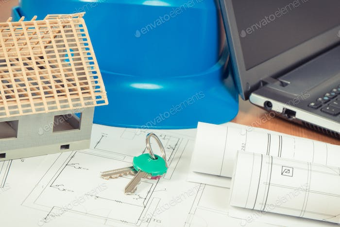 Home keys, small house, electrical diagrams with laptop for engineer jobs, building home concept