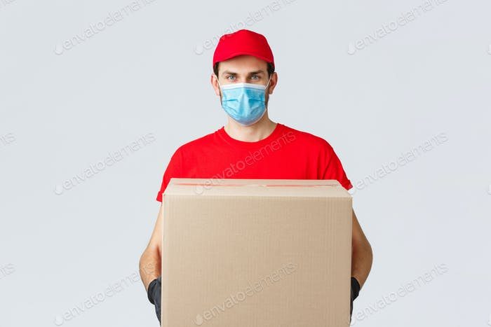 Groceries and packages delivery, covid-19, quarantine and shopping concept. Serious courier in red