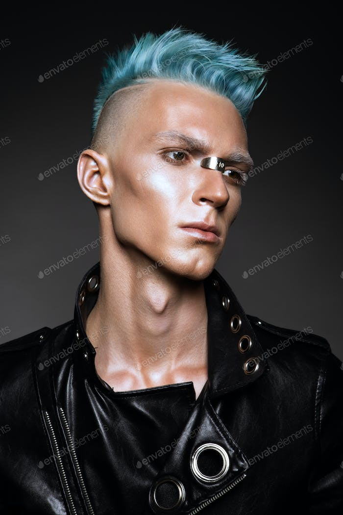 Profile of a handsome man with blue hair