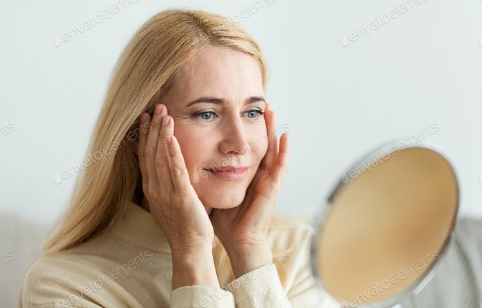 Perfect skin. Middle-aged woman satisfied with her skin