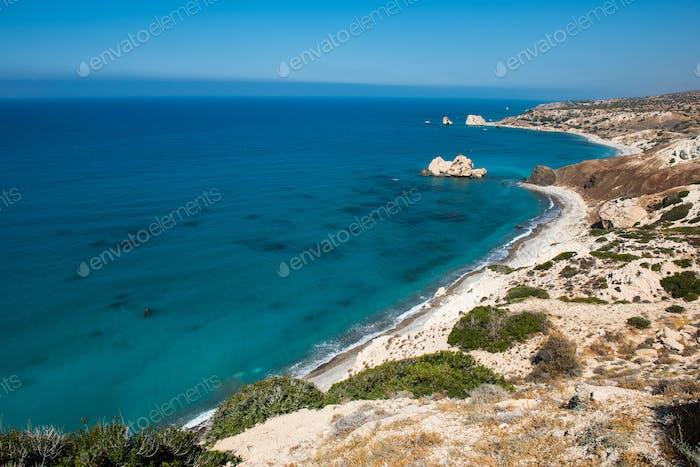 Rocky coastline on the Mediterranean sea in Cyprus. Petra tou Roumiou