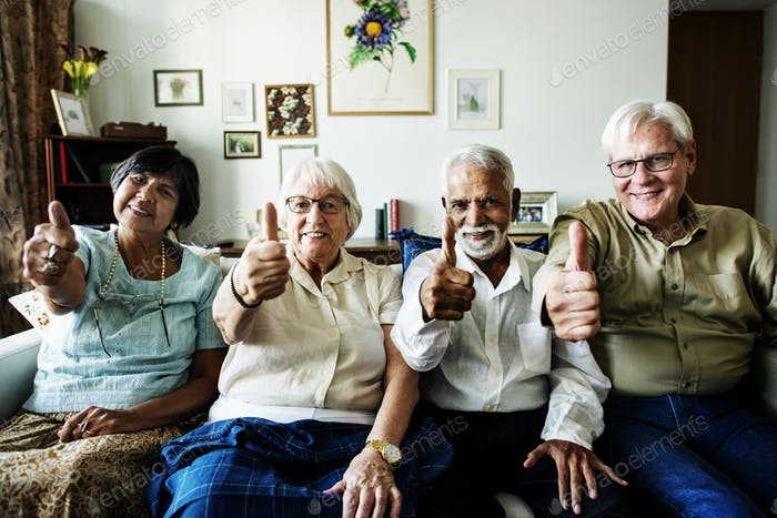 Senior friends gesturing thumbs up