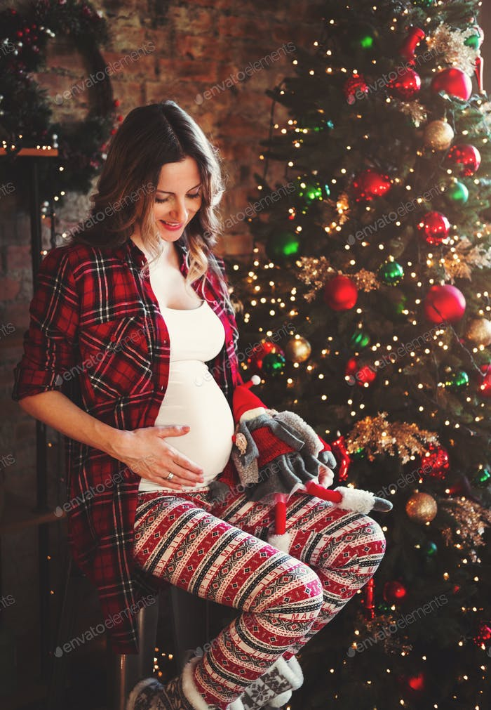 Happy beautiful pregnant woman
