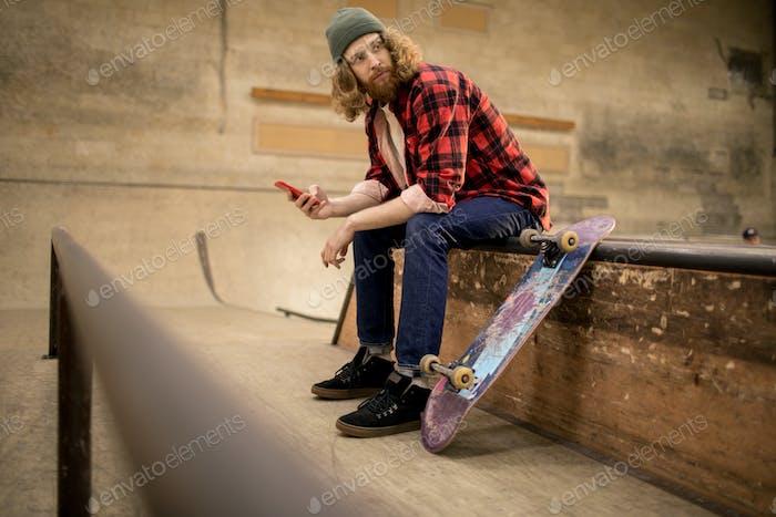 Skater Holding Smartphone