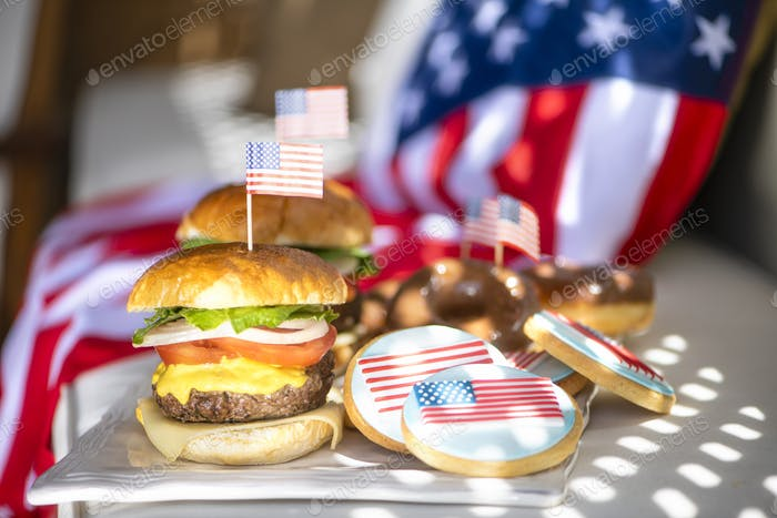 American beef burger and Cookies with American flag icing for independence day