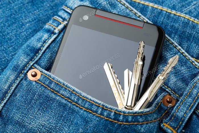 Blue jean pocket with mobile and key