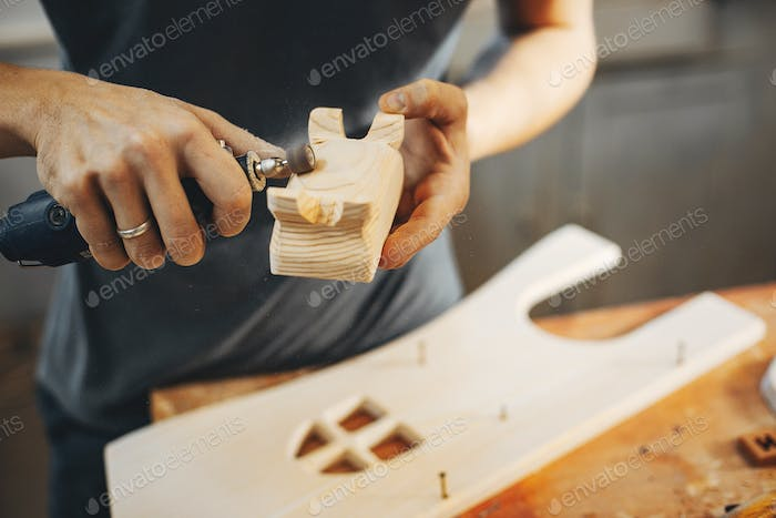 Thumbnail for The carpenter works with a tree