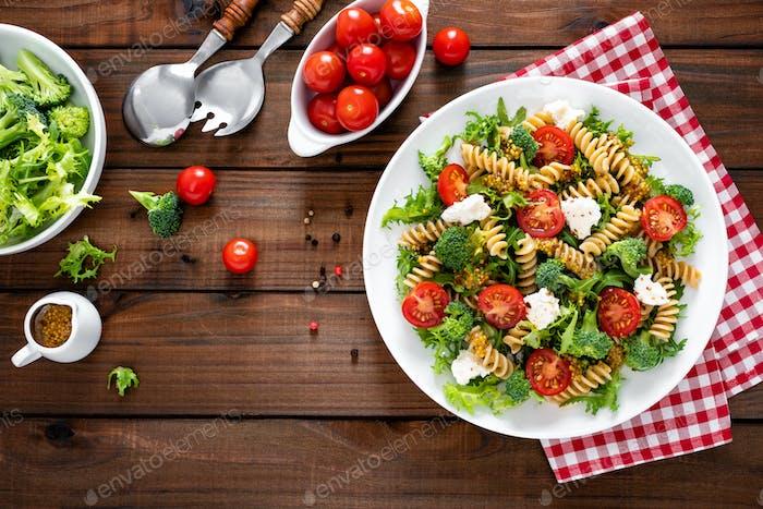 Italian pasta salad with wholegrain fusilli, fresh tomato, cheese, lettuce and broccoli