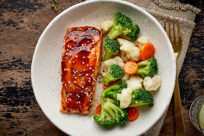Steam salmon and vegetables, Paleo, keto, fodmap, dash diet. Mediterranean food with steamed fish.