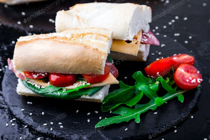 Sandwich with jamon, arugula, tomatoes