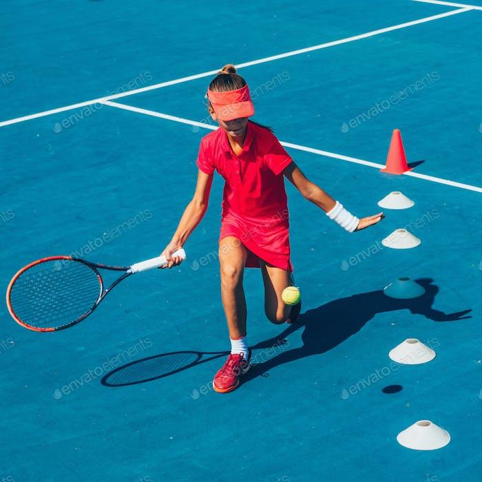 Girl on tennis training