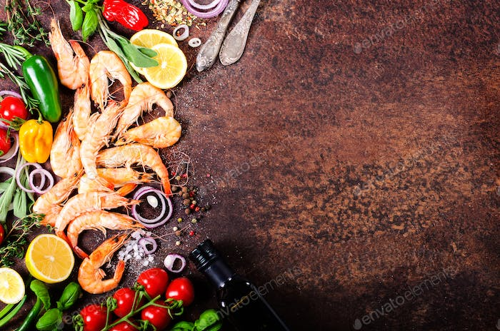 Fresh fish, shrimps with herbs, spices and vegetables on dark vintage background. Healthy food, diet