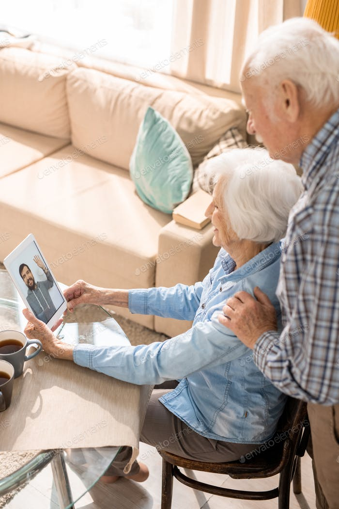Senior Couple Using Video Chat to Talk to Family