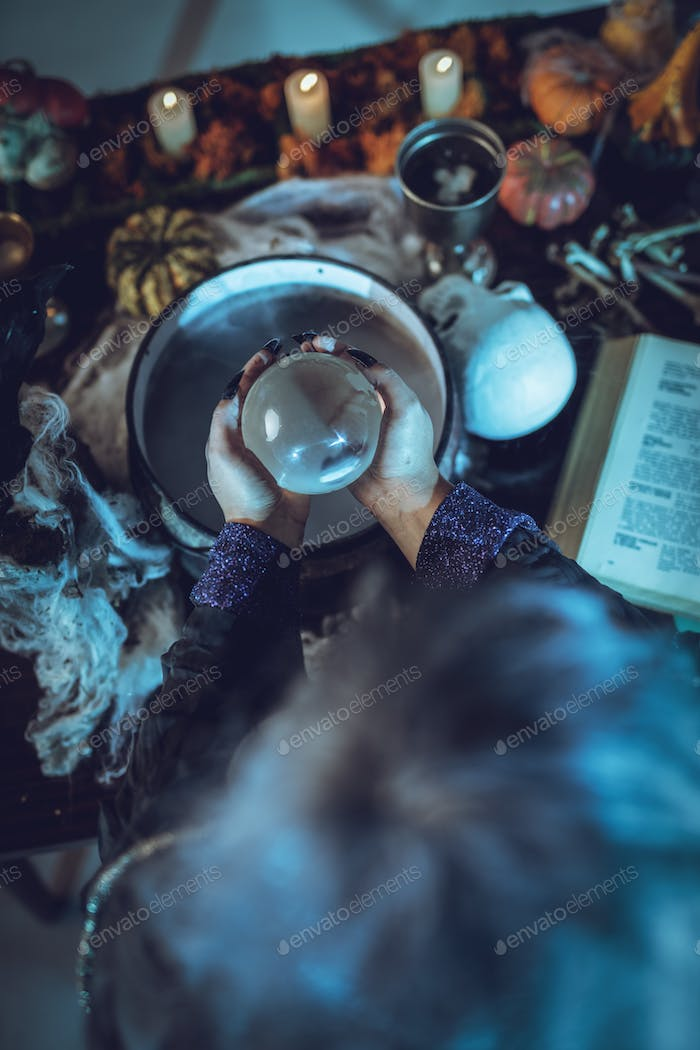 Magic Ball In Witch's Hands