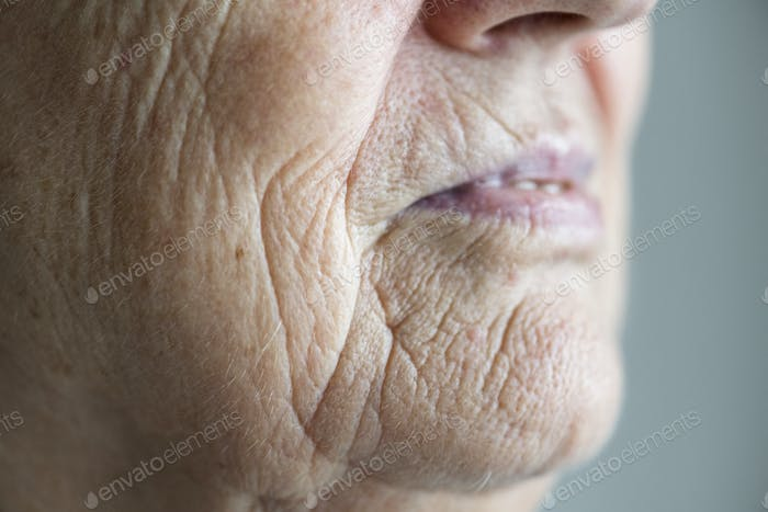 Side portrait close up of elderly woman's mouth
