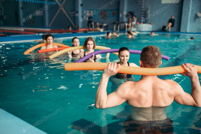 Instructor and group on workout in swimming pool