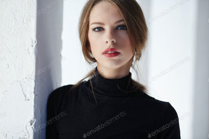Classic portrait of woman in black clothing
