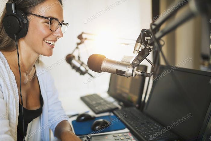 Attractive Young Woman Making Online Podcast Radio Talk Show
