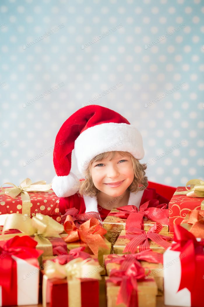 Child holding Christmas gift boxes