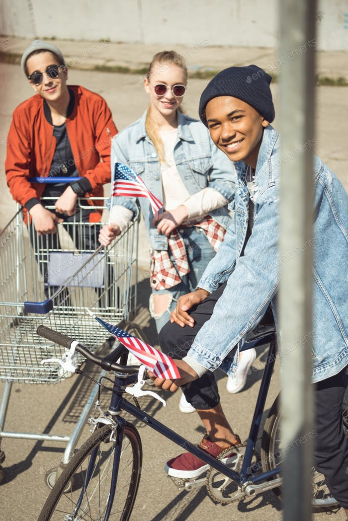 Teenagers Having Fun With Shopping Cart and Bicycle in Skateboard Park, Hipster Students Concept