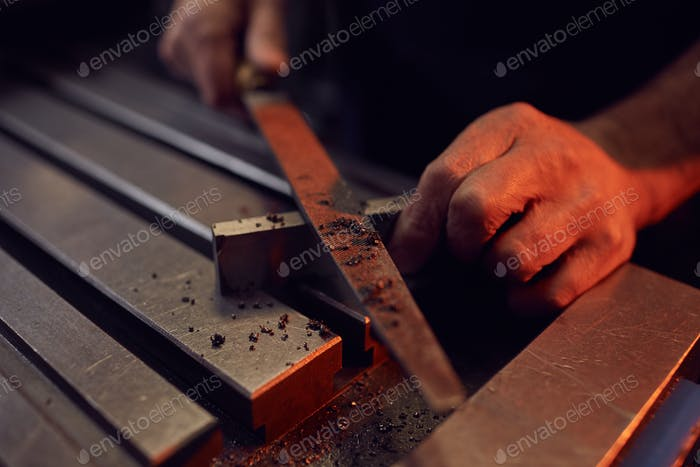 Worker working with metal