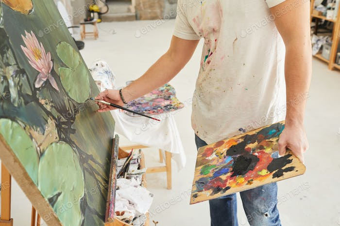 Unrecognizable Male Artist Painting Picture in Studio