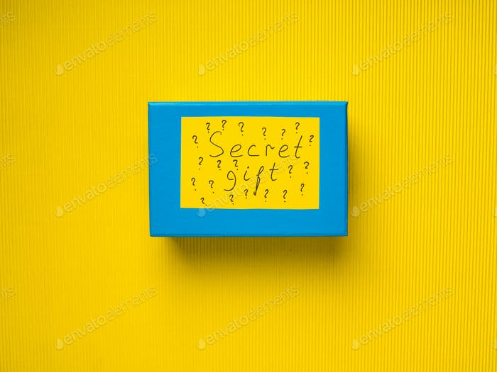 Blue surprise gift box on yellow background