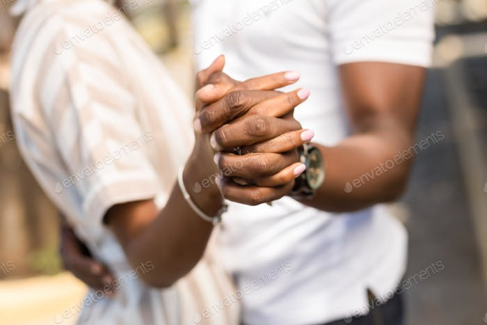 Close up outdoor protrait of black african american couple embra