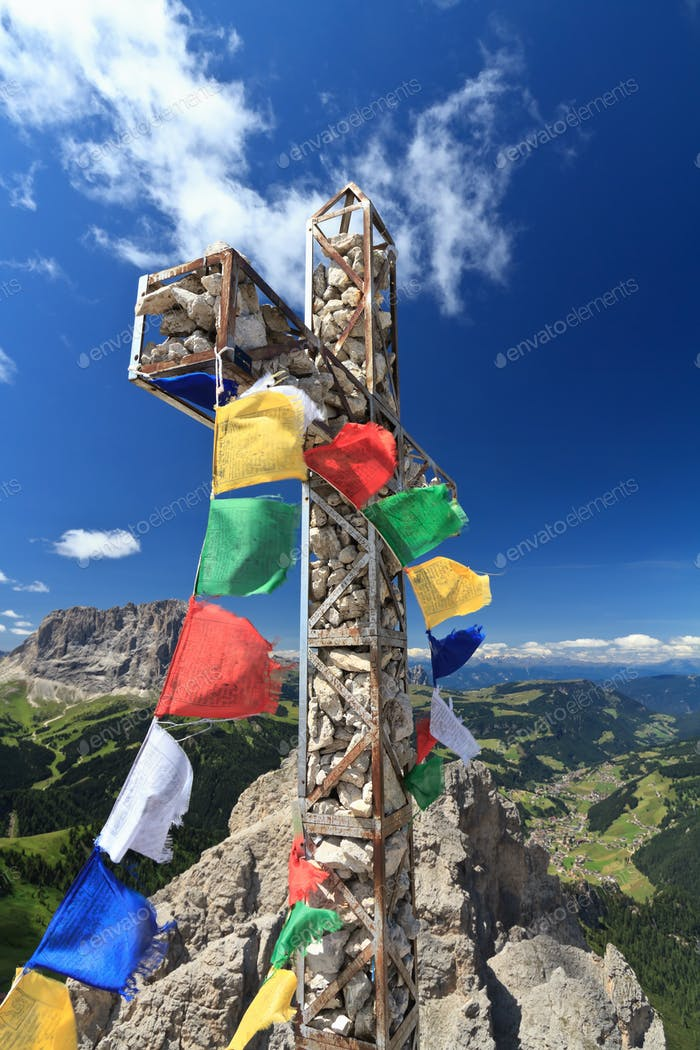mountain cross with flags
