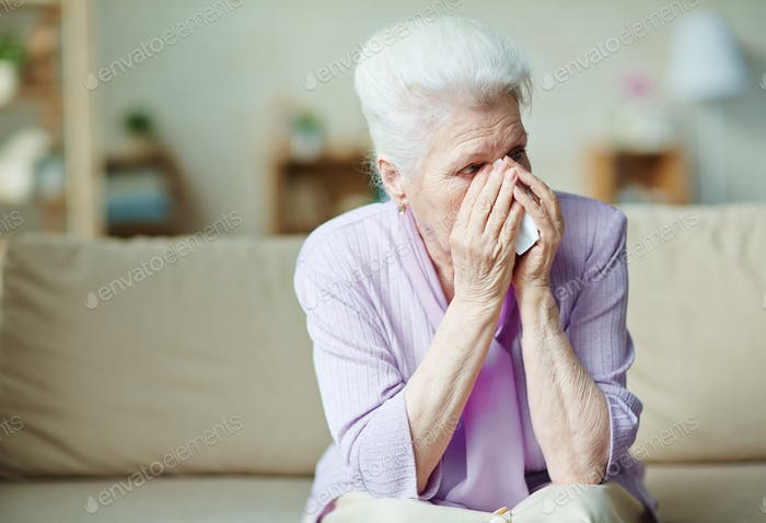 Crying elderly woman