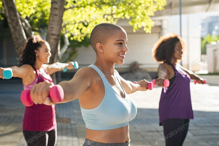 Three curvy women exercising with dumbbells