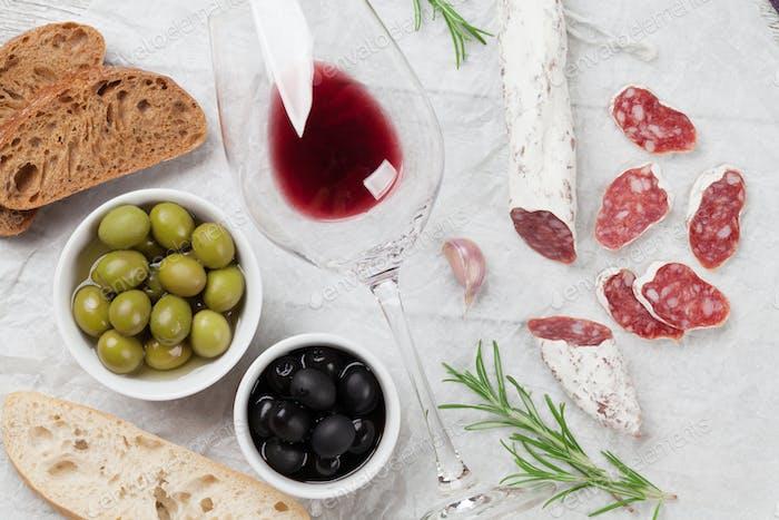 Salami, sausage, olives and wine