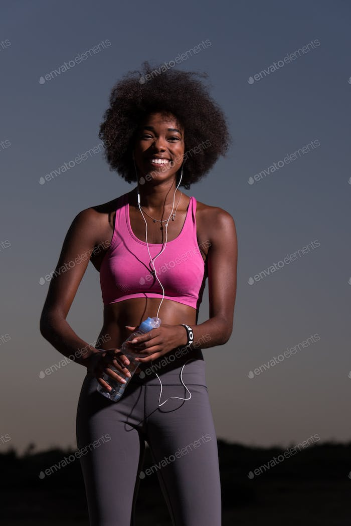 african american woman jogging in nature