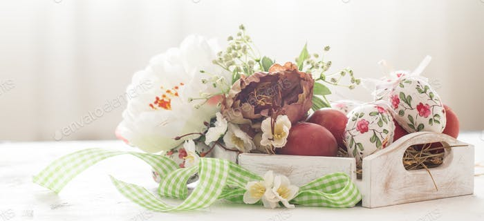 Easter background with a basket and red eggs with flowers