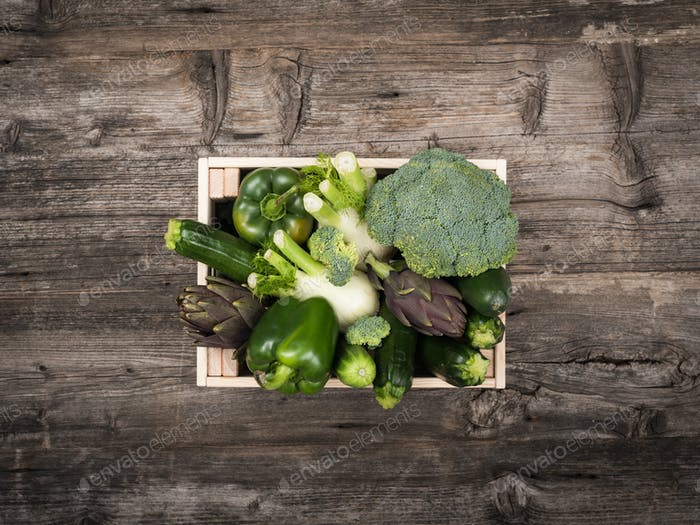 Fresh tasty vegetables in a wooden crate