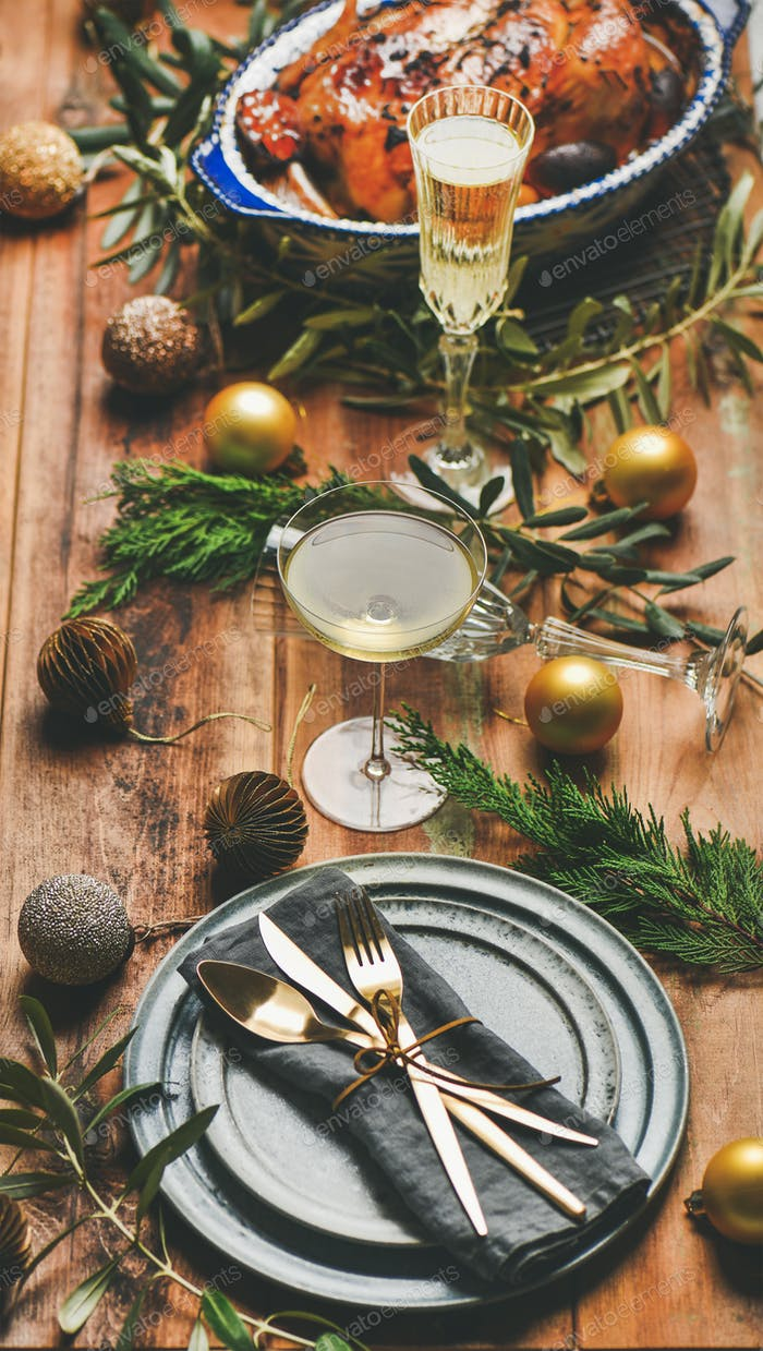 Holiday celebration table setting over rustic wooden background, selective focus