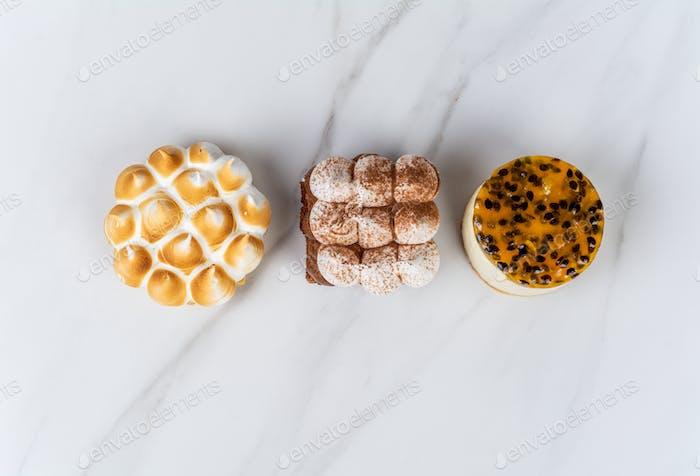 Mini chocolate, lemon pie and passion fruit cake.