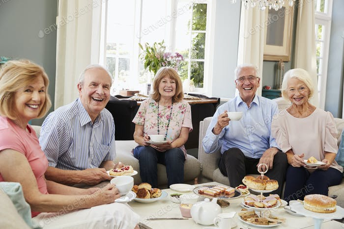 Portrait Of Senior Friends Enjoying Afternoon Tea At Home
