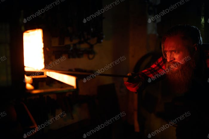 Blacksmith by furnace