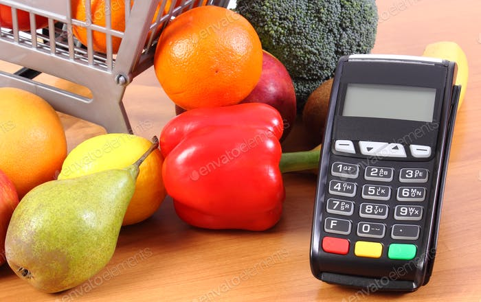 Payment terminal with fresh fruits and vegetables, cashless paying for shopping