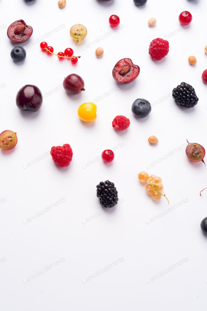 Mix of berries isolated over white background table.